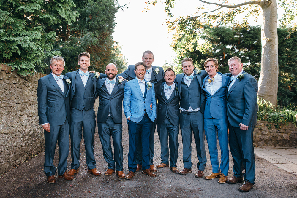 Bristol whimsical wedding. Groom and men in blue.
