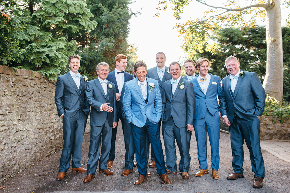 Bristol whimsical wedding. Groom and men in stylish blue outfits