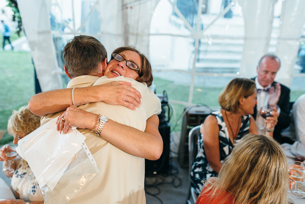 mother of groom hugging guests
