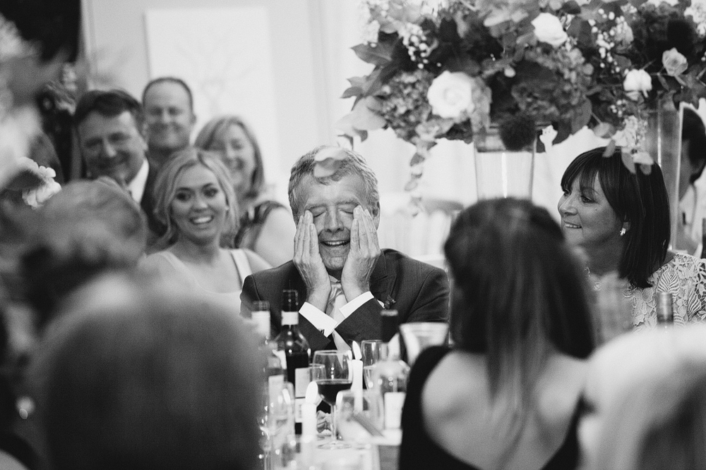 father of the bride laughing at wedding speech