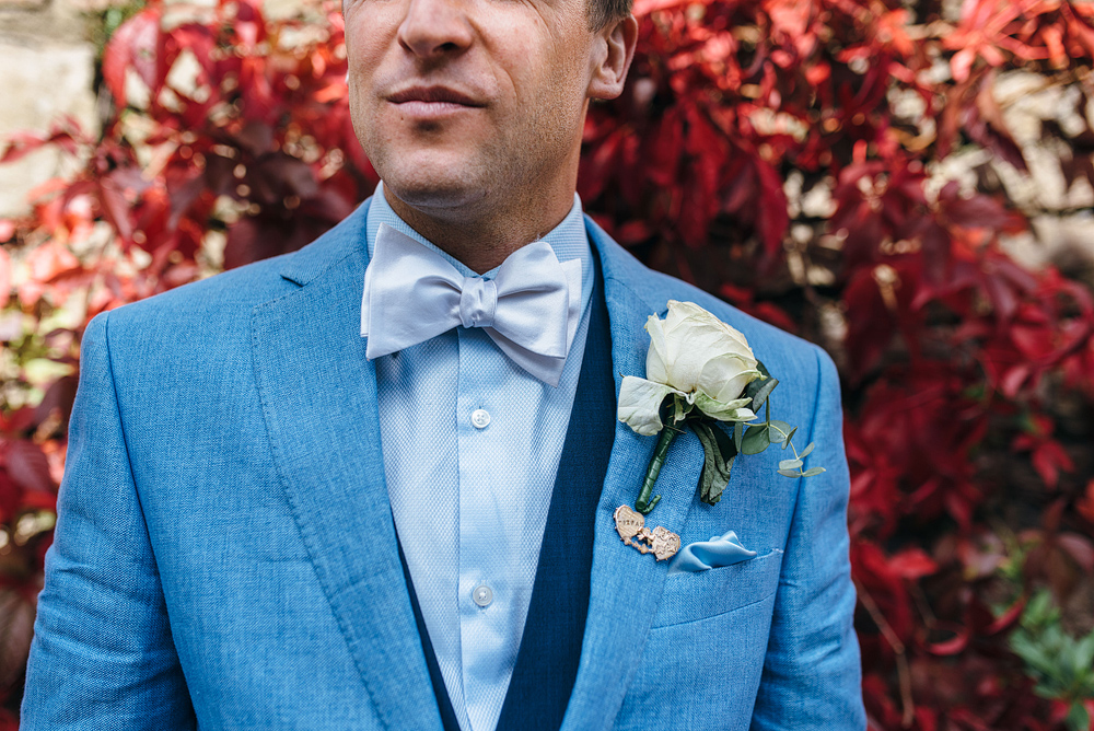 groom in blue jacket and buttonhole. Stylish wedding ideas