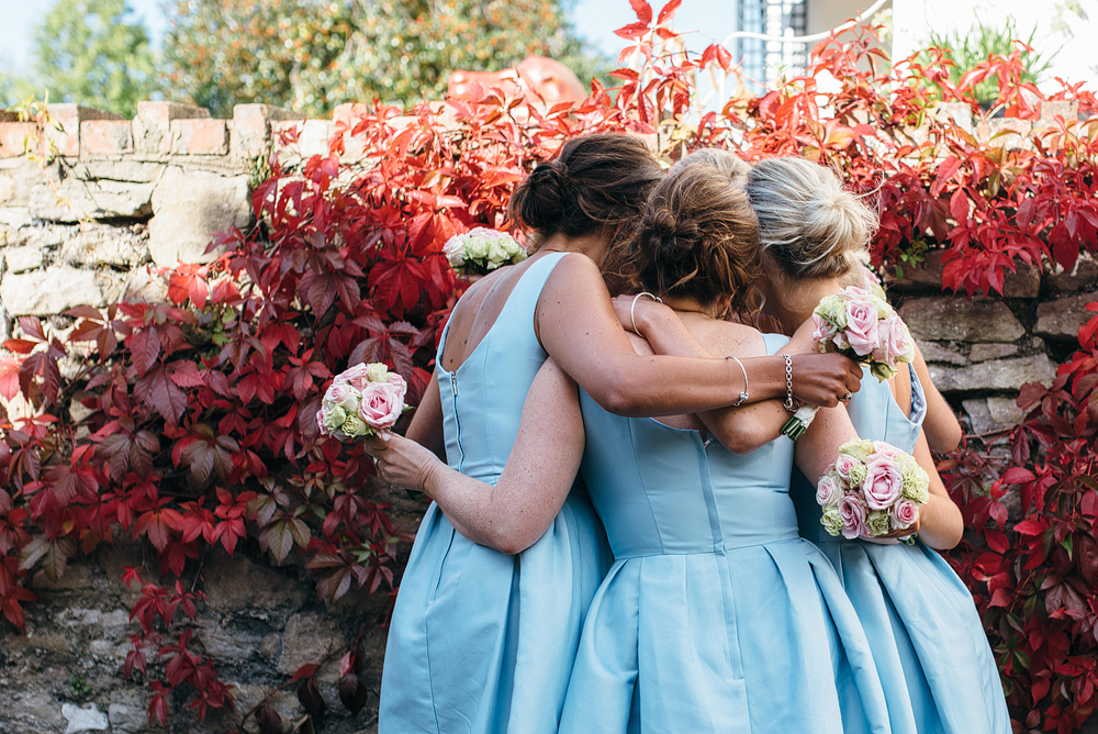 bridesmaids having a group hug