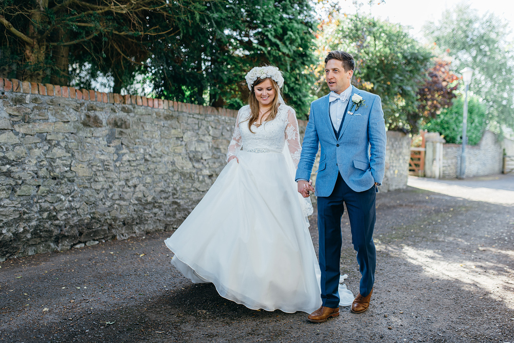 Bristol whimsical wedding bride and groom hand in hand