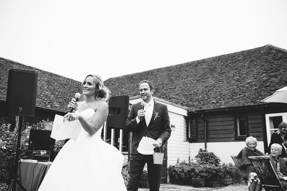 bride and best friend performing speech at reid rooms wedding