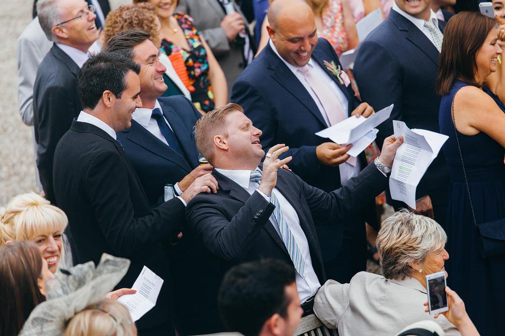 groomsmen singing at wedding