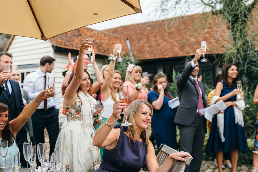 bridal party all rasing a toast