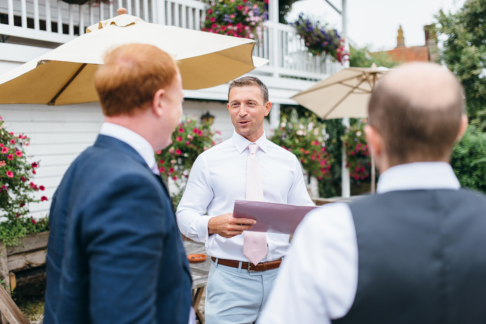 Groom talking with guests outside