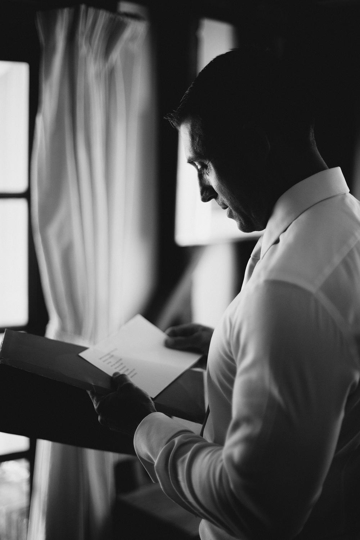 Groom reading in suite
