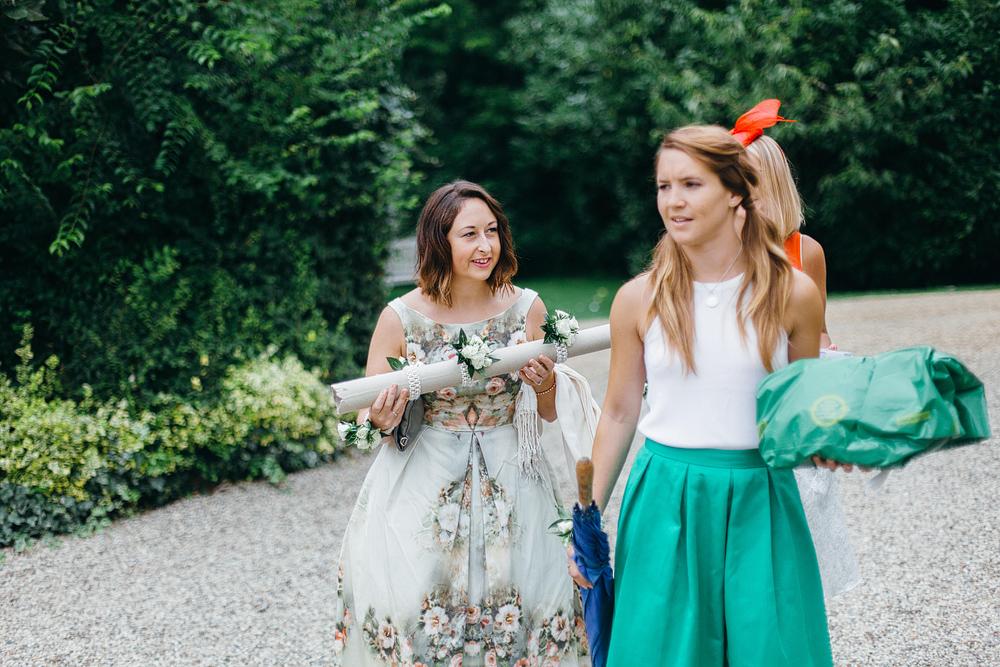 Wedding guests walking along path