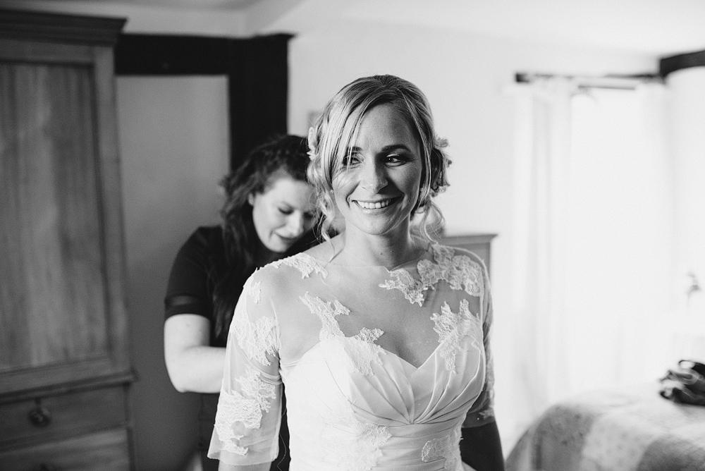 Bride smiling preparing for wedding ceremony