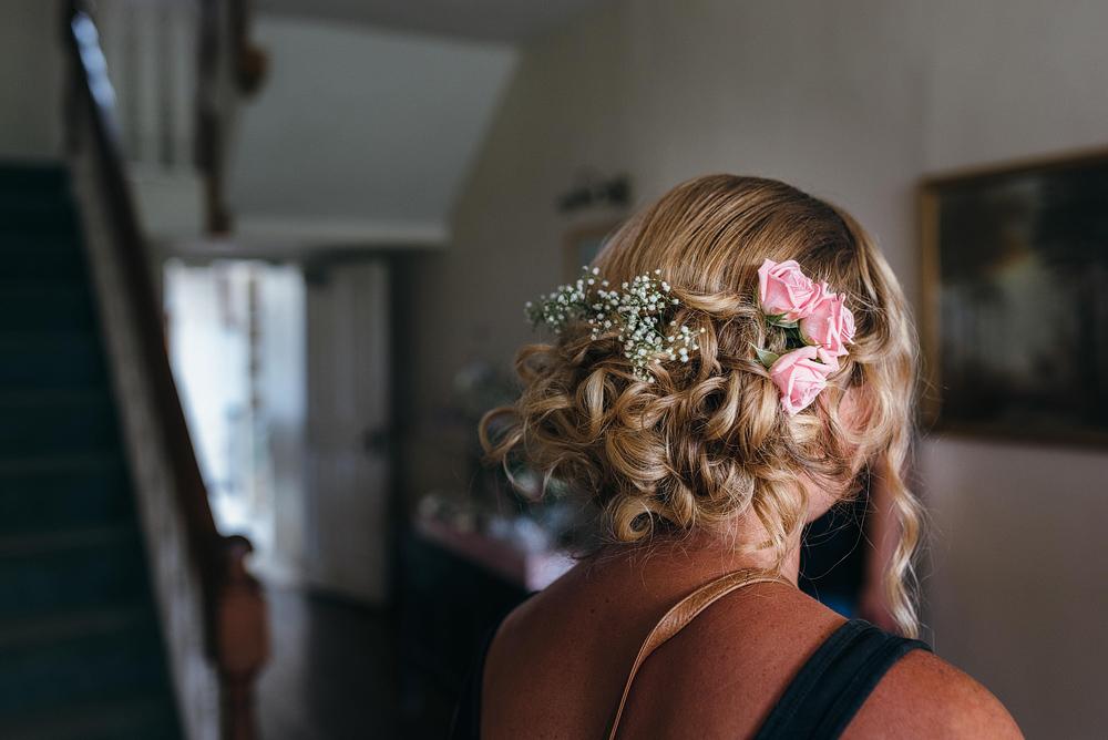 Bride's hair preparing for wedding ceremony
