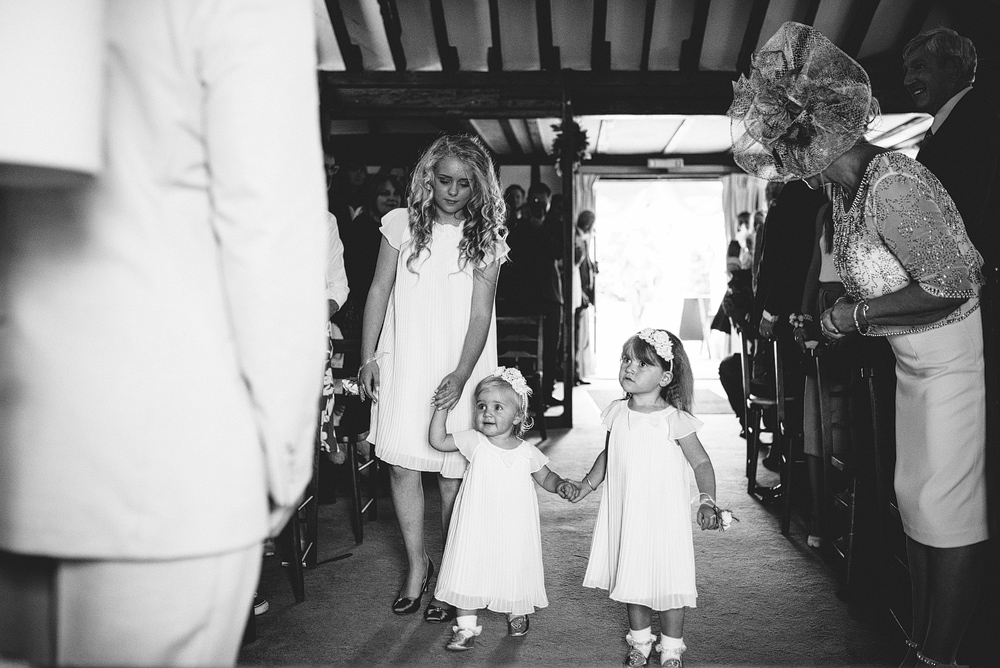 Flower girls walking down the wedding aisle