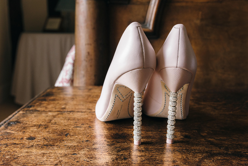 Bride's shoes on table