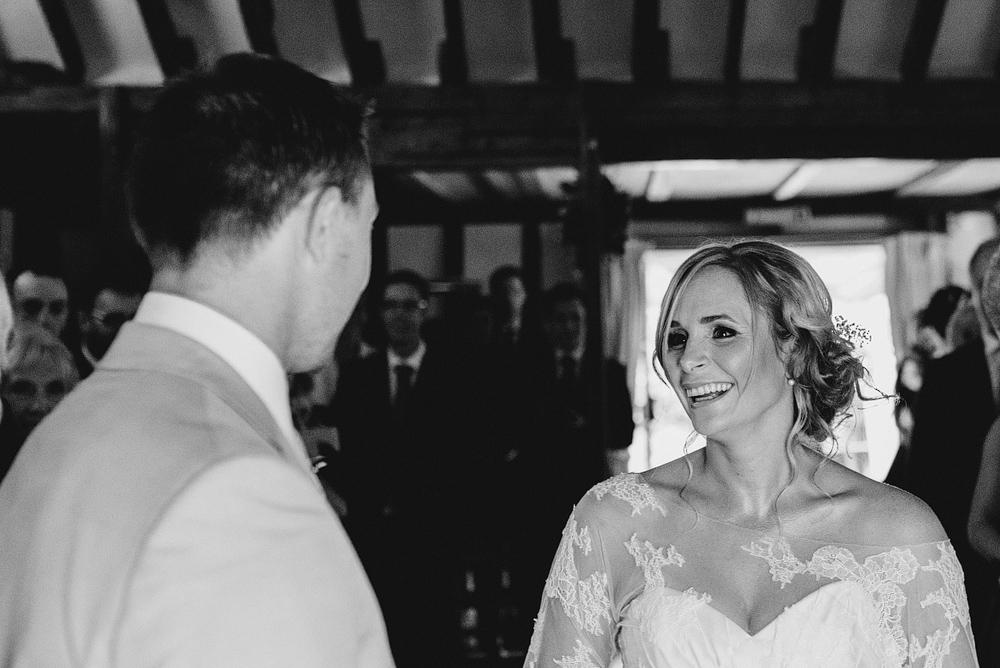 Bride smiling looking at groom at wedding altar