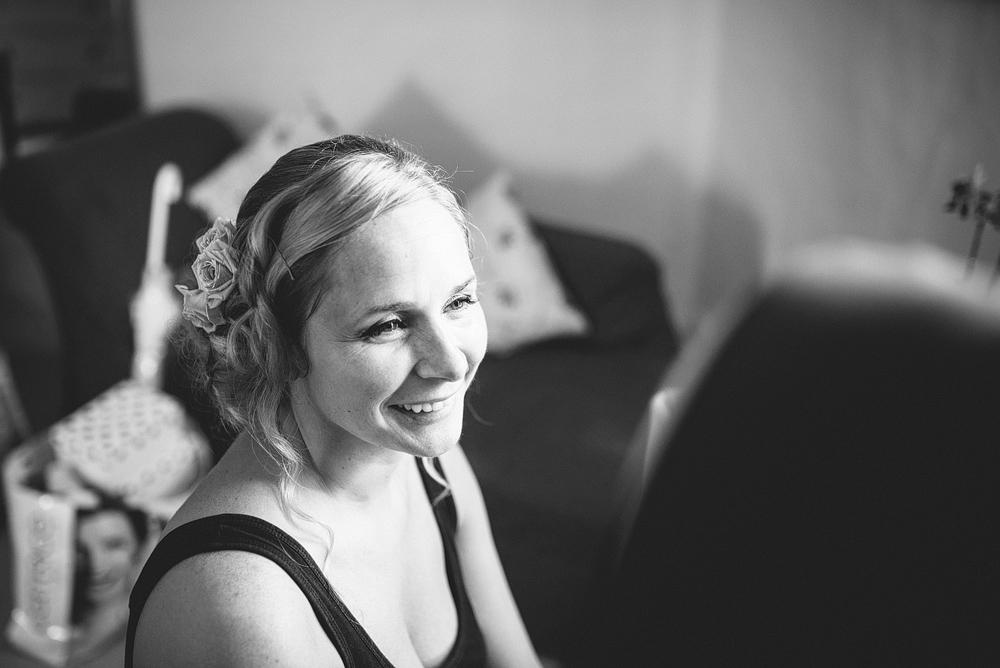 Bride smiling in bridal suite