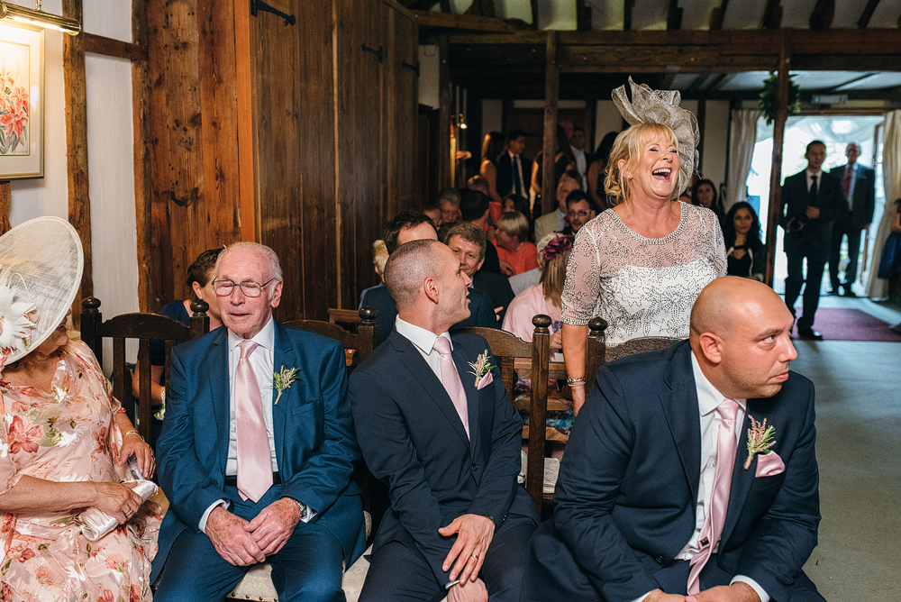 Wedding guests sitting and laughing at reception