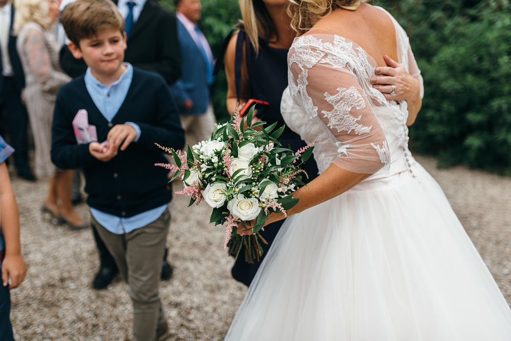 Side view of bride and bouquet