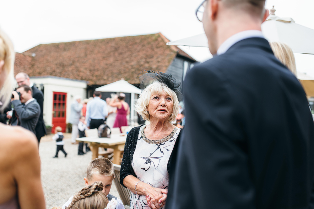 Woman talking with wedding guests outside