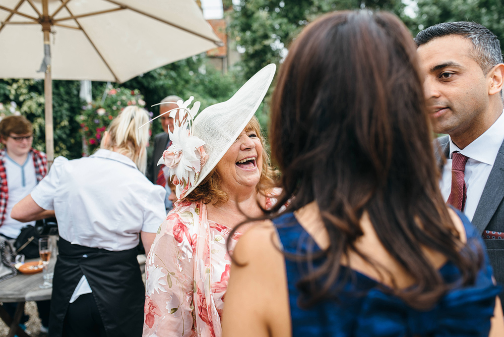 Guest laughing at wedding reception