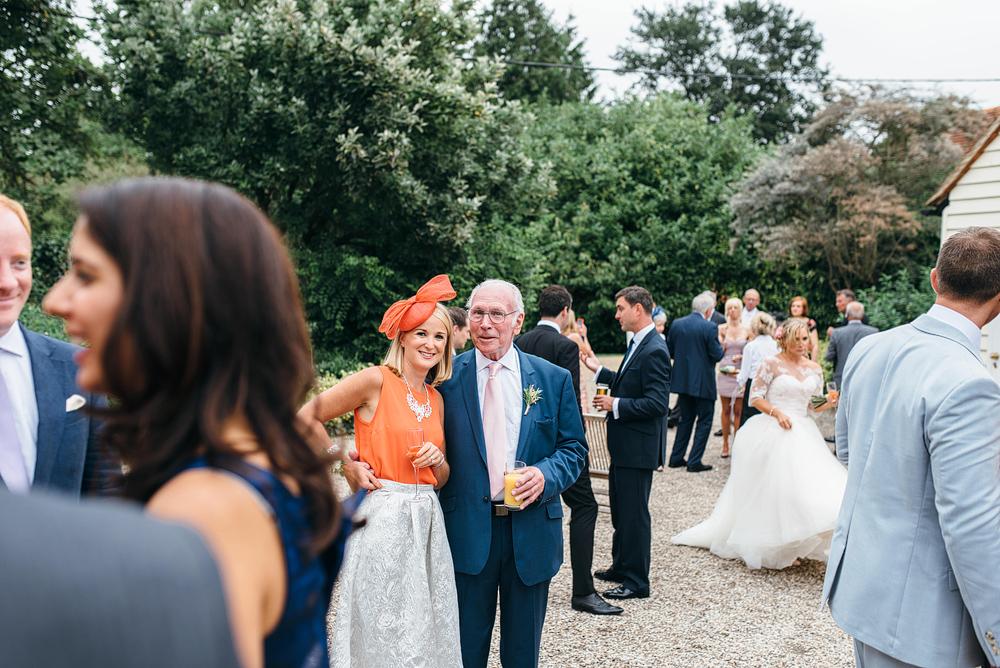 Wedding guests talking outside together