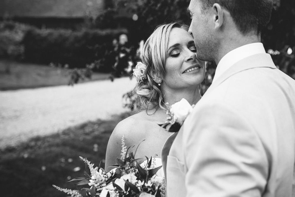 bride cuddling groom with eyes closed at reid rooms