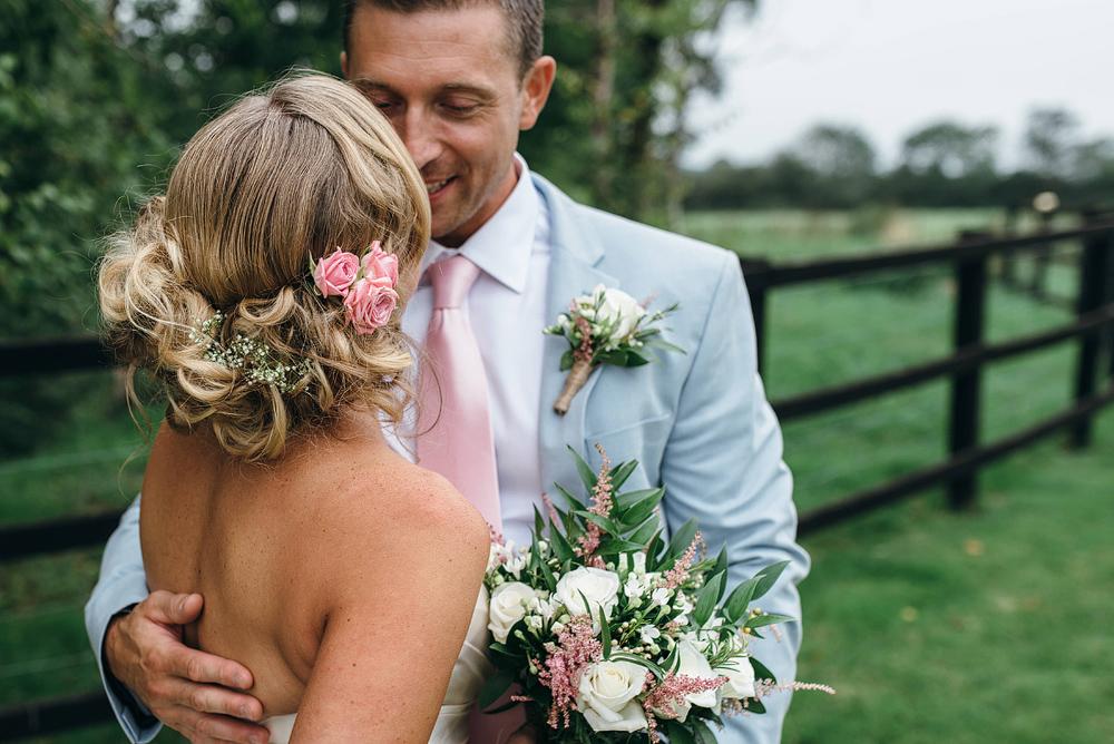 bride and groom cuddling at reid rooms wedding