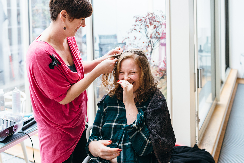 Guests laughing having hair styled