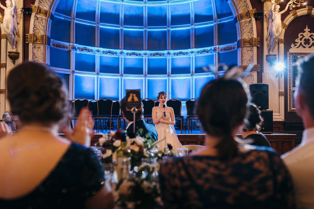 Bride giving speech at wedding reception