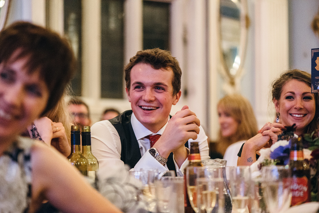 Wedding guests smiling at table