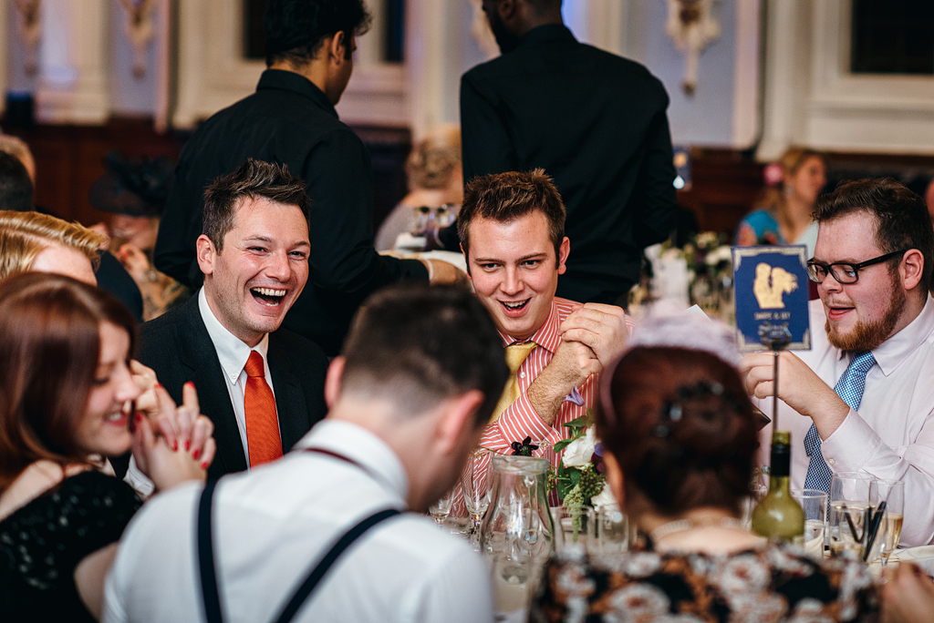 Table of wedding guests laughing together