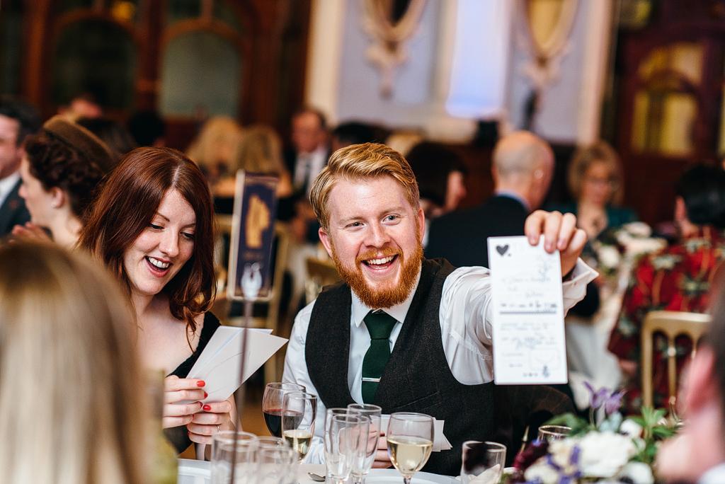 Guests smiling at table at wedding reception