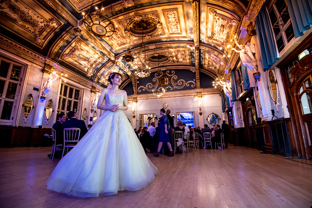 Bride standing alone on dance hall