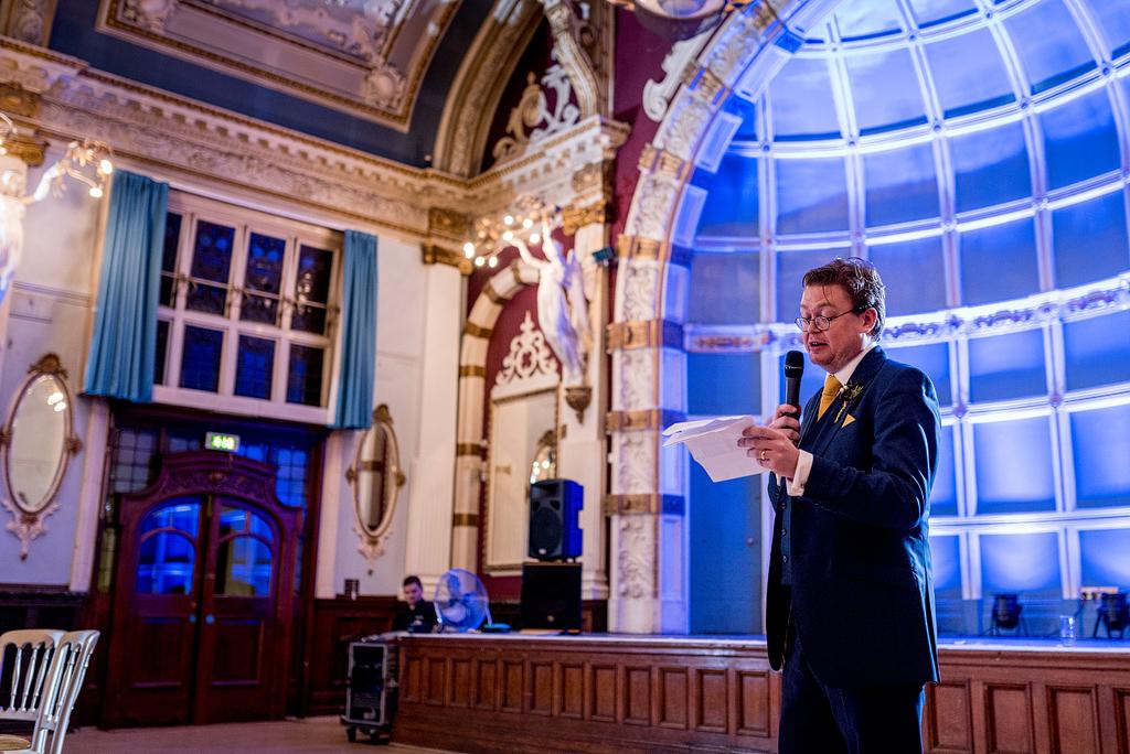 Groom giving speech at wedding reception