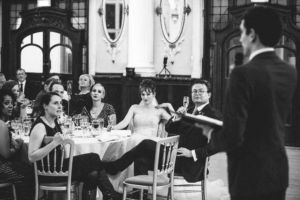 Man speaking at wedding reception