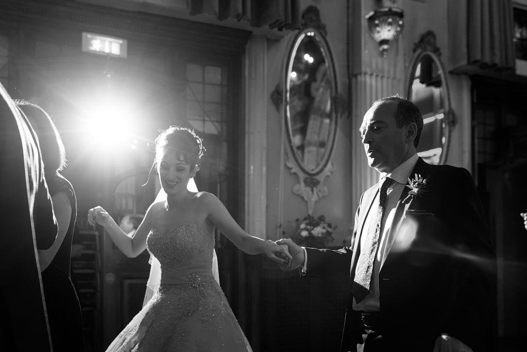 Bride dancing with man at wedding reception