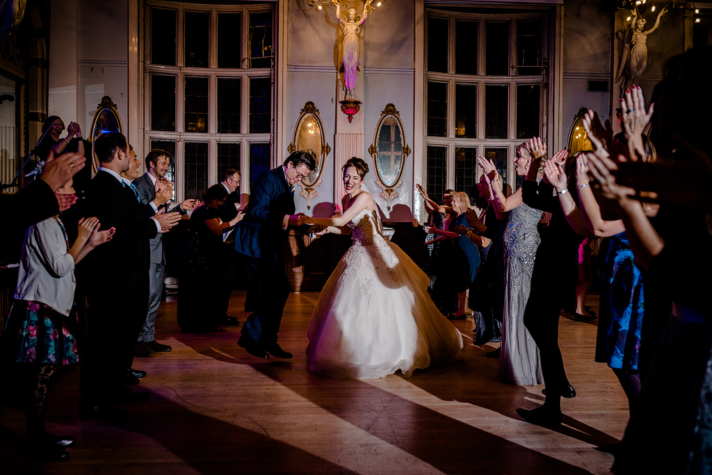 Bride laughing and dancing at wedding reception
