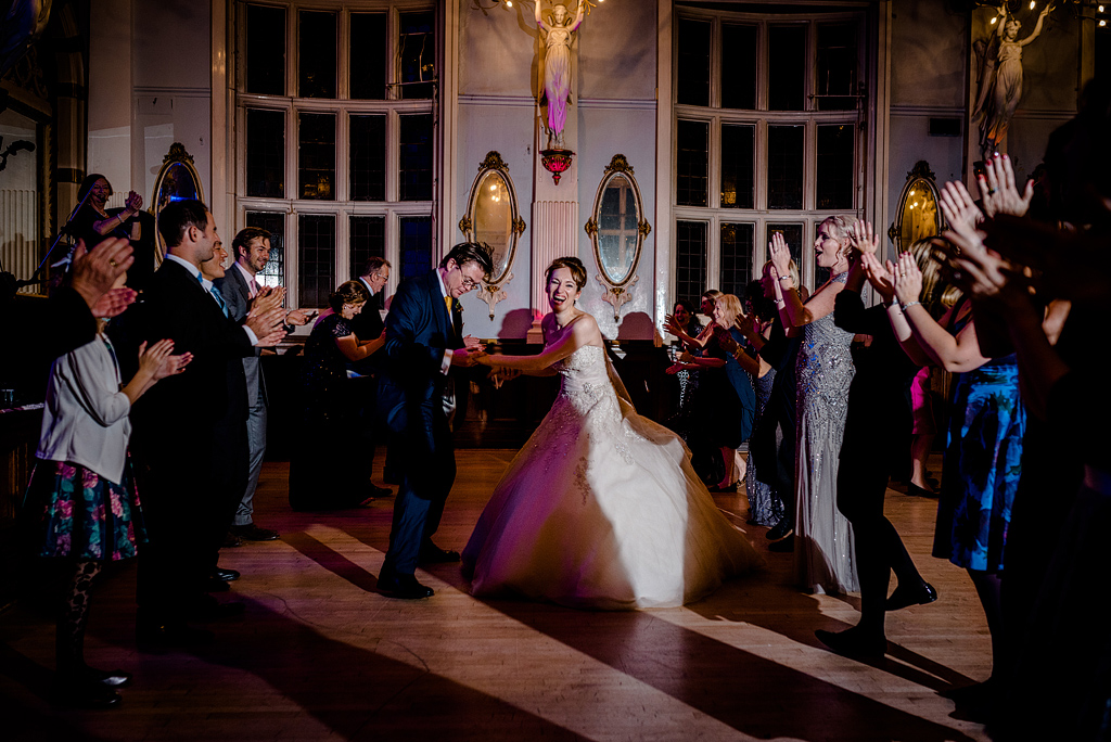 Bride laughing while dancing at wedding reception