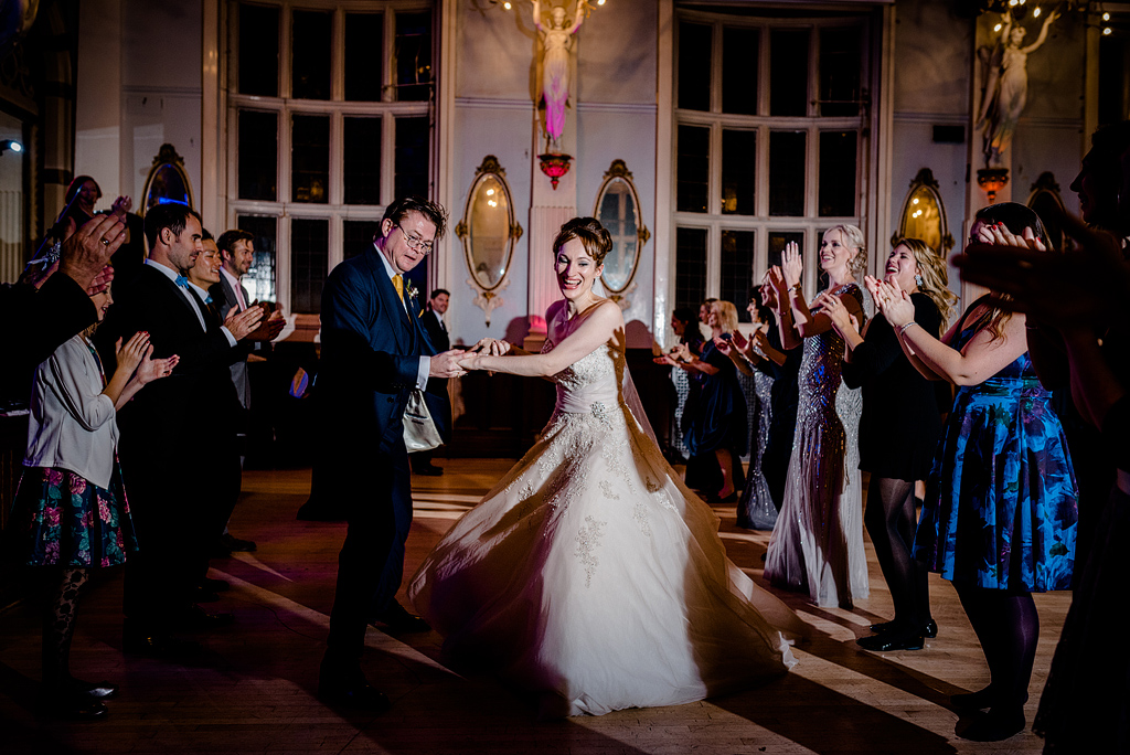 Bride smiling while dancing at reception