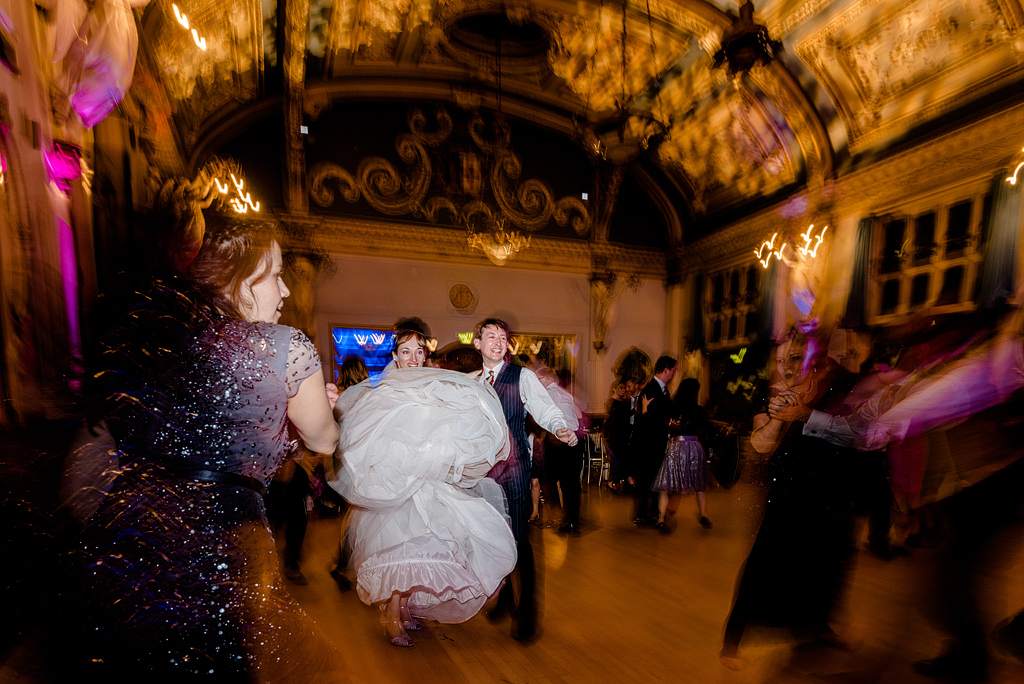 Blurry guests dancing at wedding reception