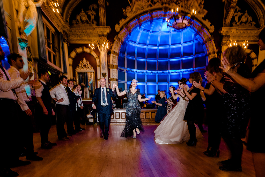 Guests dancing in line at wedding reception