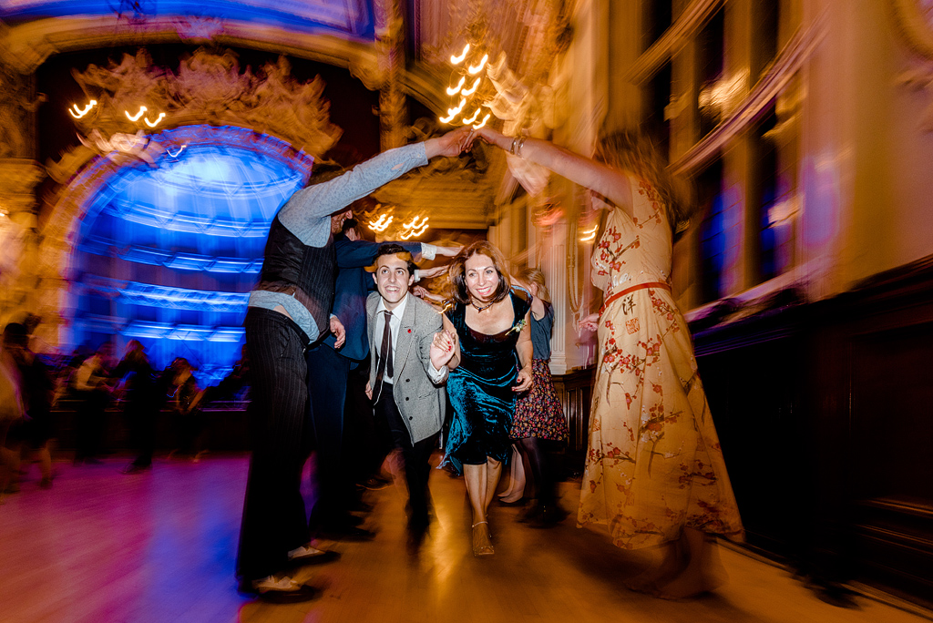 Guests running under tunnel of arms