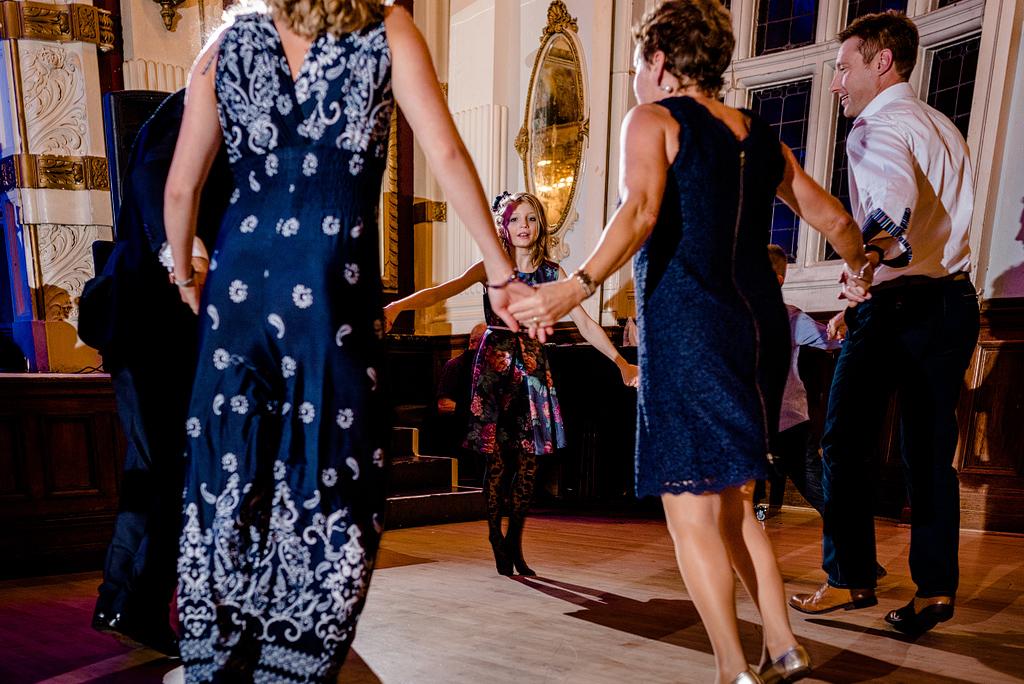Wedding guests dancing in circle