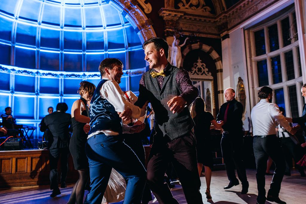Two men dancing on wedding dance floor