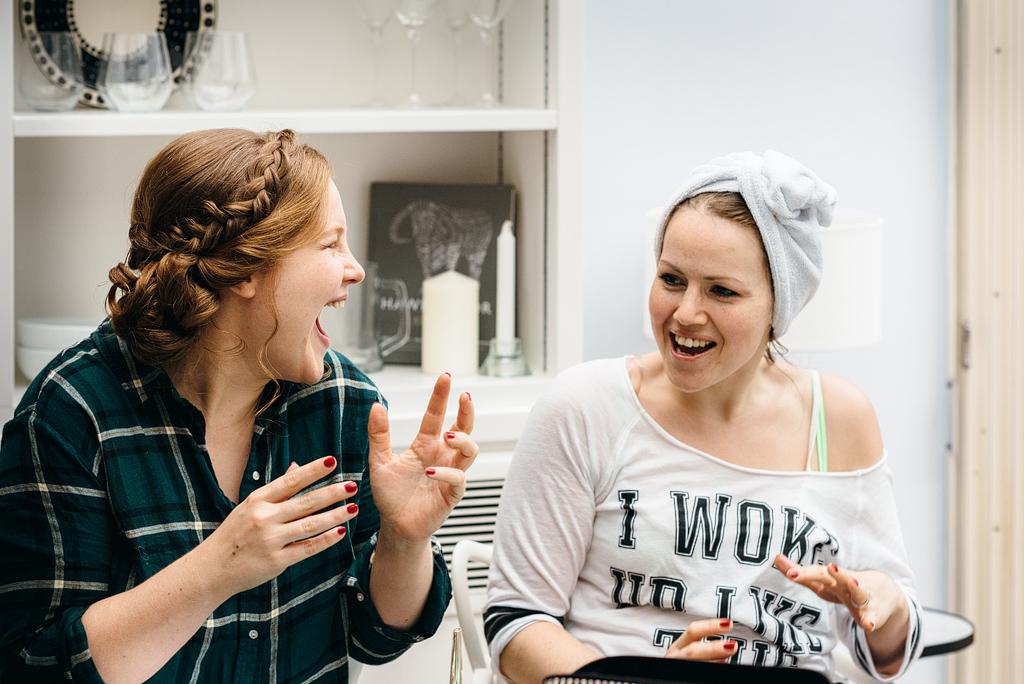 Bridesmaids laughing drying nails