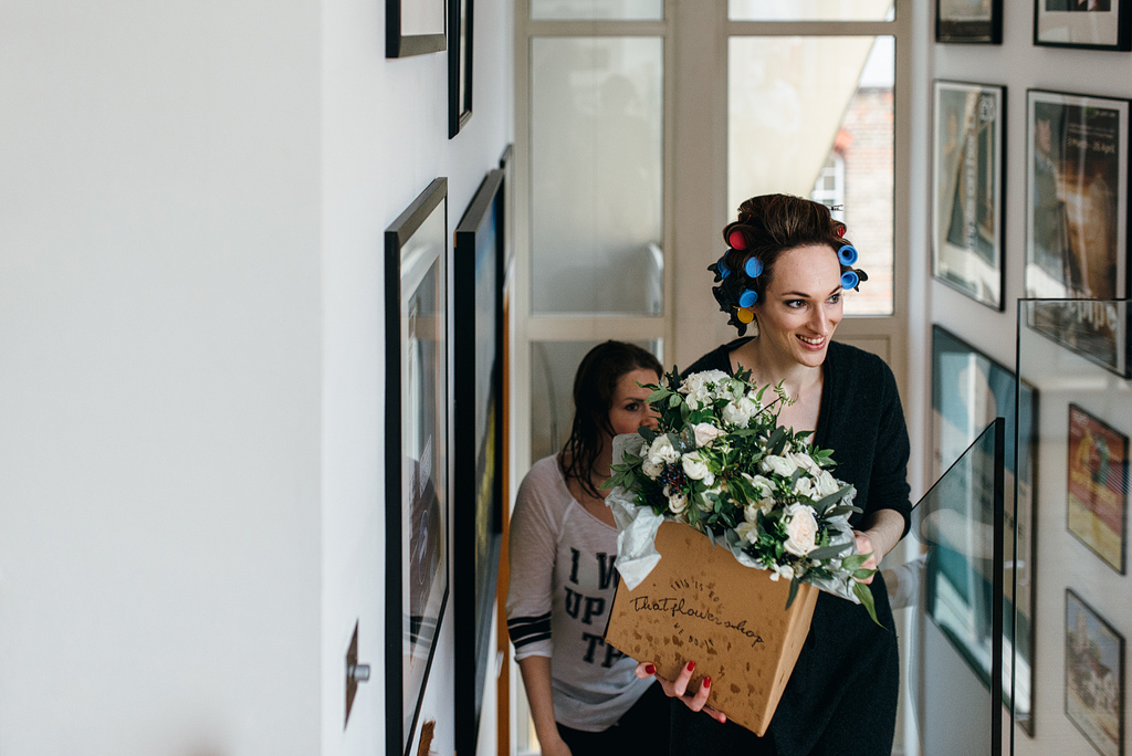 Bride walking up stairs with bouquets of flowers