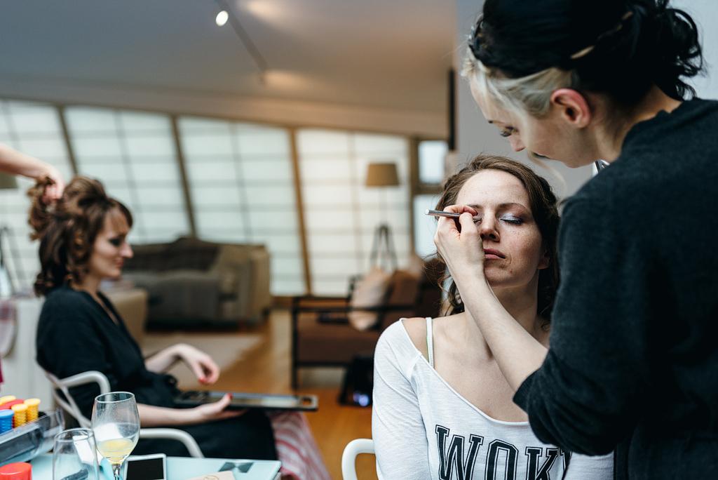 Wedding guests having makeup done