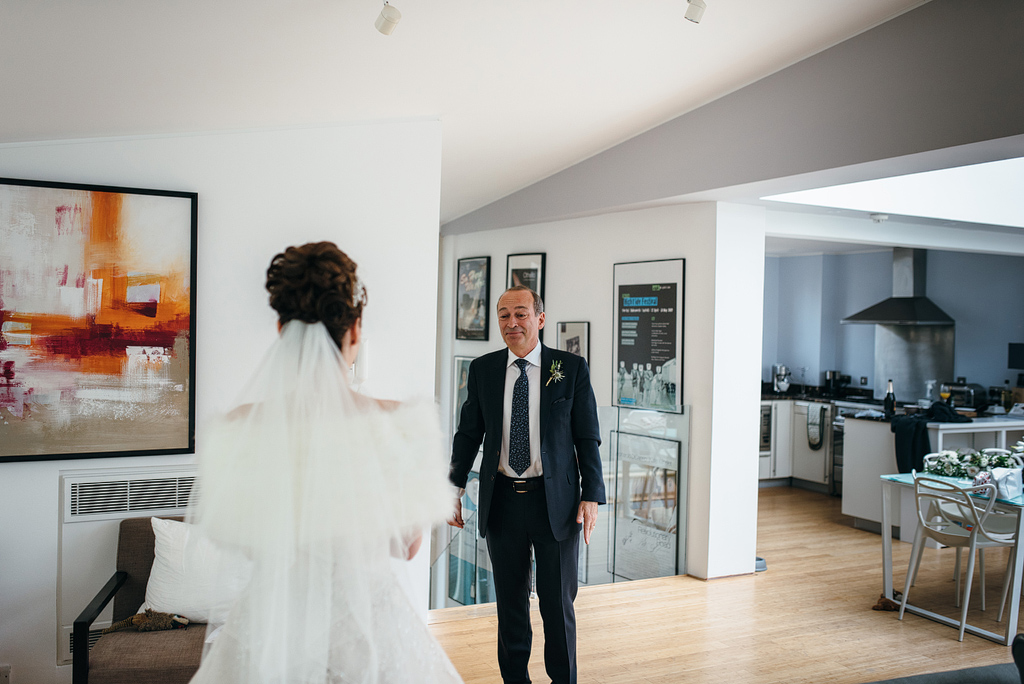 Father seeing bride in dress