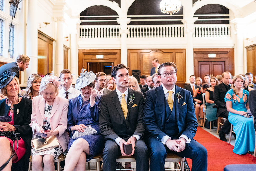 Guests sitting at wedding ceremony waiting to begin