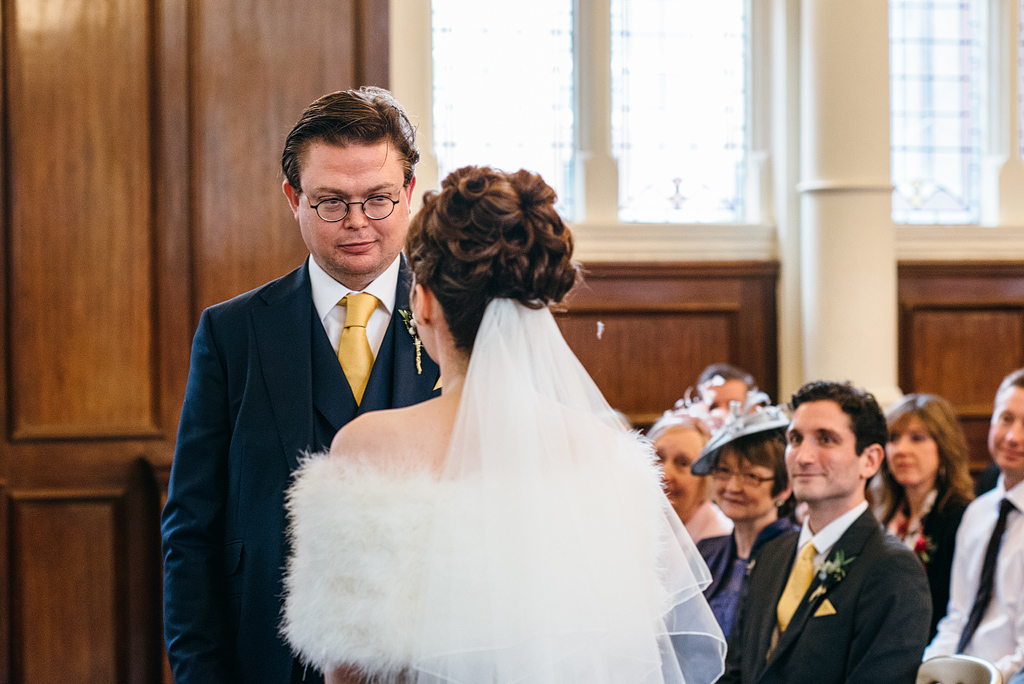 Bride and groom looking at each other at wedding ceremony