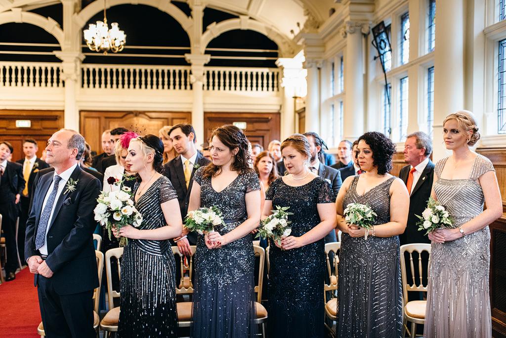 Bridesmaids standing at wedding ceremony